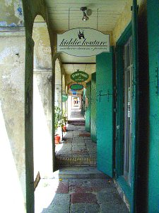 VI cities Christiansted sidewalk shops arches